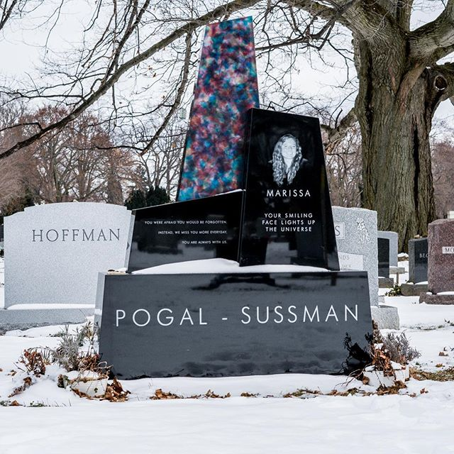 A special memorial we created in Mt. Hope Cemetery, Rochester, NY. Crushed cast glass, absolute black granite. The glass changes throughout the day and through the seasons depending upon light, position of the sun, and the environment around it. Loving these photos by Julia Merrell on a snowy winter day! #lundgrenmonuments  #glassmemorial  #colorfulcemetery  #mthopecemetery