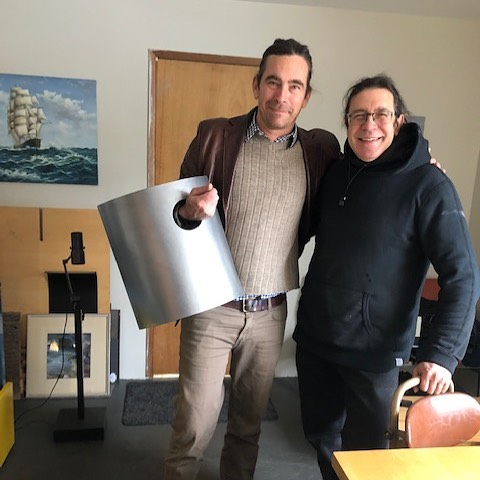 "Greg Lundgren holding the large version of the Empty Space urn with master metalworker Paolo Croatto. Everything we make is custom, so when a family asked for a 16"" tall version of our originally 8.5"" tall steel urn, we scaled it up and just learned to carry it different. And it's a beauty! #lundgrenmonuments  #cremationurn  #tinyhome  #moderndeath"