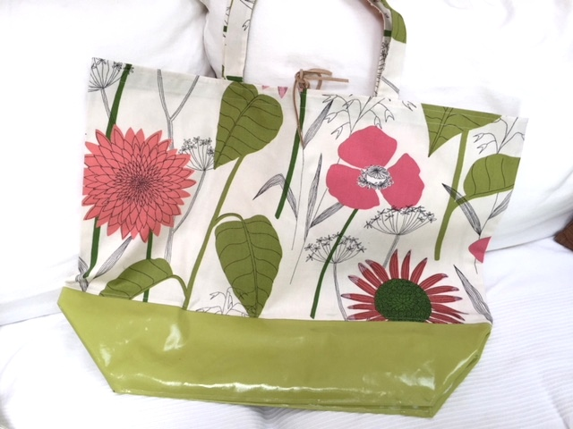 A cute beach bag made from FabMo fabric and a water resistant bottom. Perfect for a day on the beach.