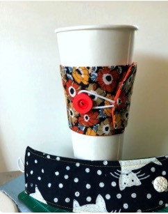 Lovely co-worker or teacher gift made from FabMo material. Think of all the cardboard sleeves a pretty, unique and personal fabric coffee cup sleeve saves!