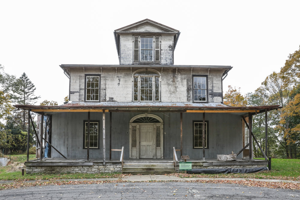 East Elevation of Dr. Oliver Bronson House, 2018. New Roof, working gutters and no water pouring in. Forty-one restored windows. The ornament and terra cotta chimney pots are in storage for future installation.