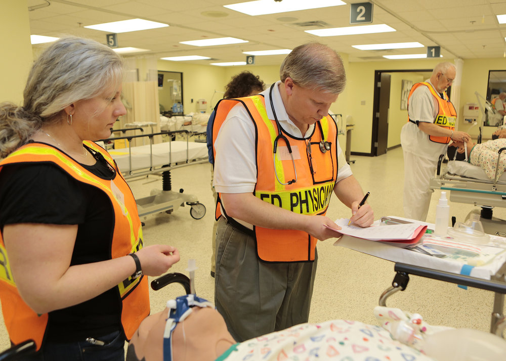 physicians-nurses-and-other-hospital-emergency-workers-respond-to-simulated-57bcbd-1600.jpg