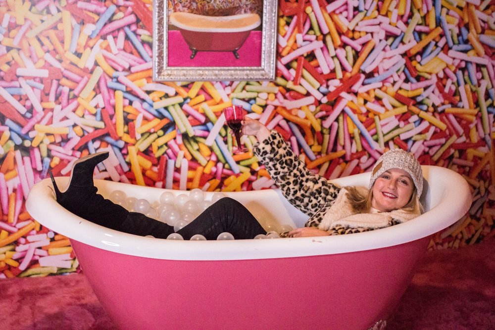 Blair Fielder enjoying the complimentary red wine in the bubble bath installation.
