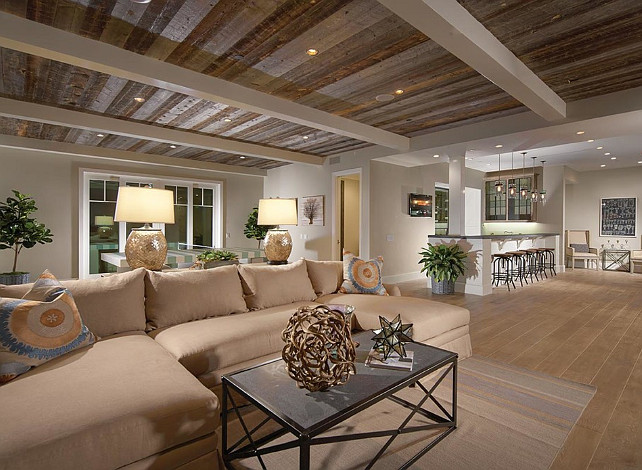 I love the idea of adding interest to the basement ceiling to give it less of a basement feel and more of a true living space. This coastal home by  Brandon Architects  did a truly amazing job with those beams and reclaimed wood!