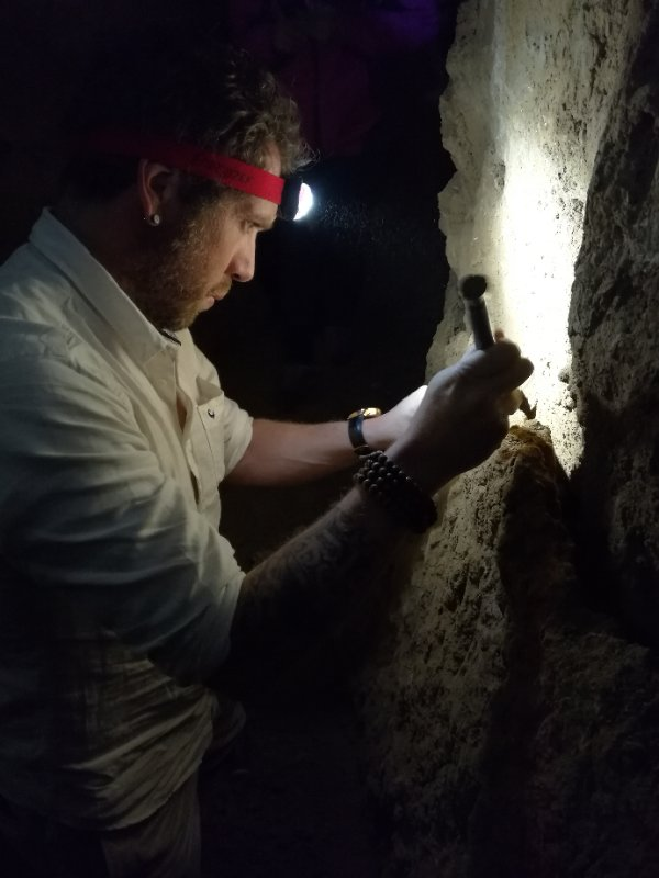 Dr Renaud Joannes-Boyau sampling in a dark cave (2017)
