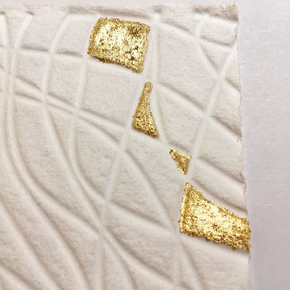 embossed paper with gold leaf.JPG