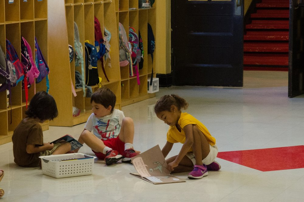 Kindergarten students work in supervised independent reading groups