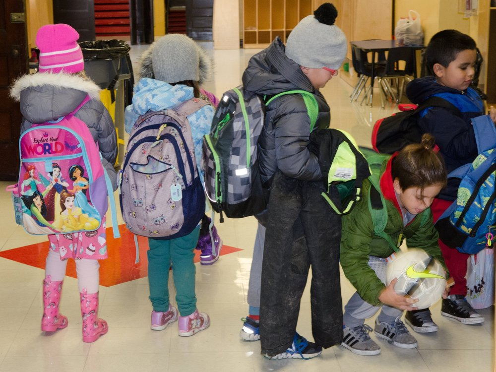 Students bundle up for dismissal. We encourage families to practice putting on boots, hats, gloves and coats at home, to make this process as smooth as possible!