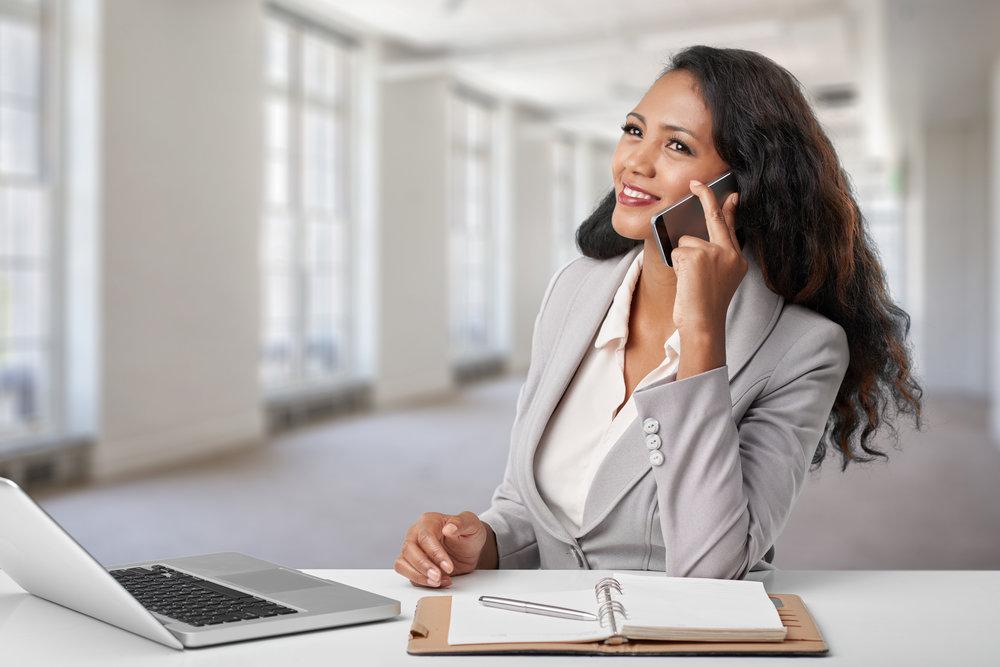 Attractive female entrepreneur having phone talk.jpg