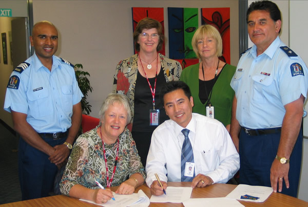 Signing the formal sponsorship agreement, 25 February 2008. Standing, from left: Sergeant Rakesh Naidoo (now Inspector); Deb Gilbertson (Coordinator of Speech Awards for Lower North Island); Susan Williams (External Relations for Police); Superintendent (now Assistant Commissioner) Wallace Haumaha. Seated, Bev Watson, National Coordinator of Race Unity Speech Awards; Kefeng Chu, Strategic Ethnic Adviser for NZ Police.