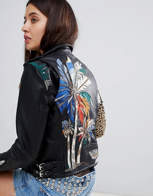 The weekday fête - Take a page out of an editor's book and expertly mix fall trends. A studded moto cast in sumptuous embroidery create an on-point interplay of textures.
