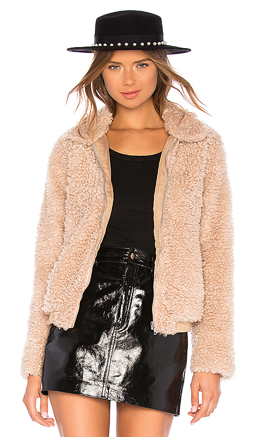 First sign of fall - The second temps drop, you'll want to break out this bomber in shaggy shearling with a high-shine finish mini (that's two key elements in one look)