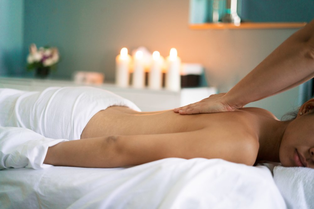 woman-getting-back-massage_4460x4460.jpg