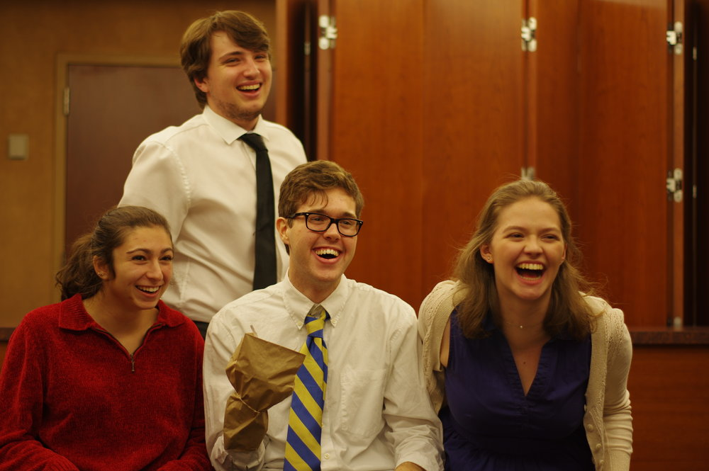 """(L to R) Sydney Rutigliano, Sam Casey, Nick Spink, and Emily Conlon in """"Mom, I Want to Be a Chemist"""" by Ryan Cook, Derek Crosby, and Jack McManus."""