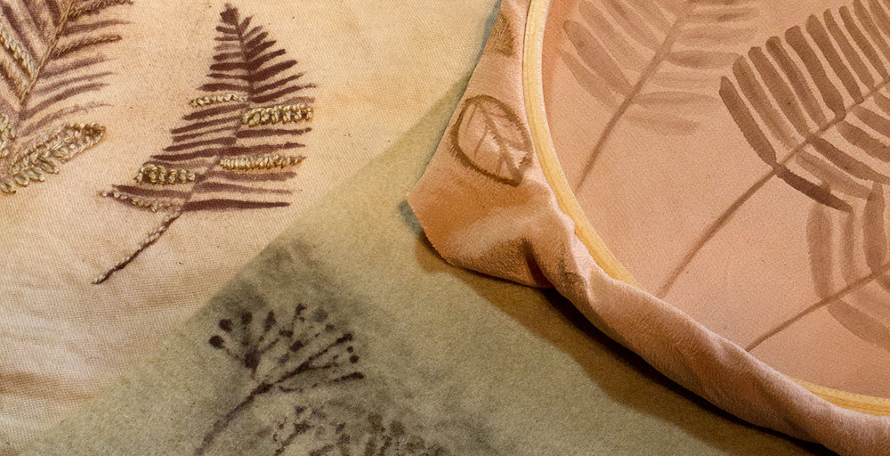 Iron oxide painted designs on natural dyed fabric