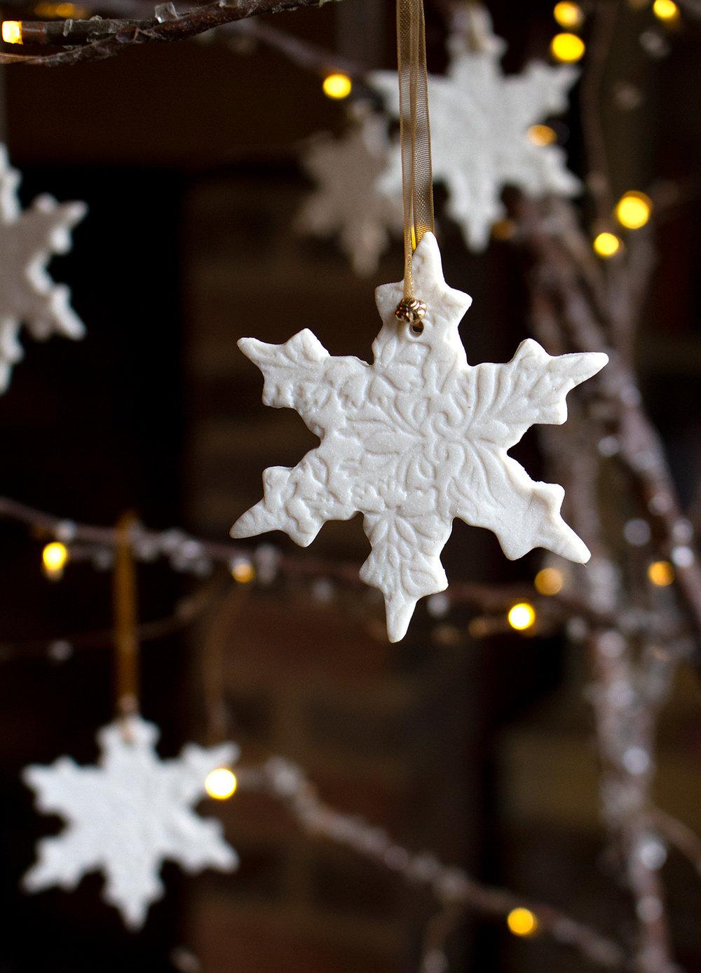 Porcelain snowflake design 1 on tree.jpg