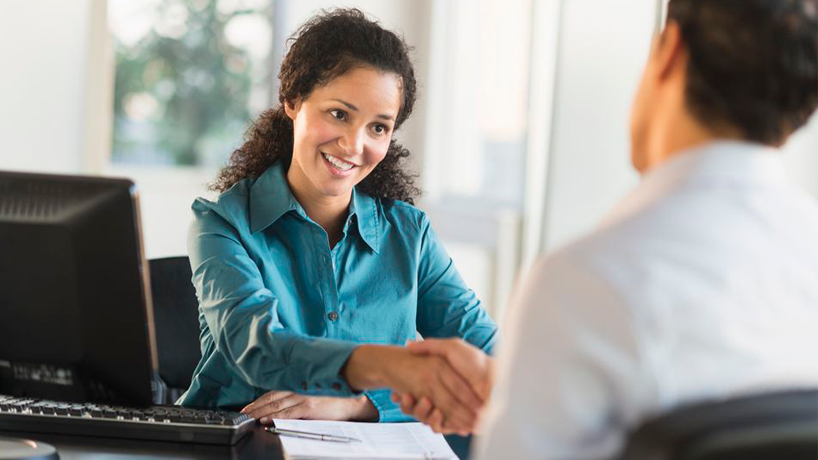 usa-new-jersey-jersey-city-woman-shaking-hand-with-man-at-desk-167456527-5775e4775f9b585875041c8a-2.jpg