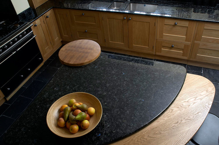 Figura bespoke kitchen design with curved island in unique oak.