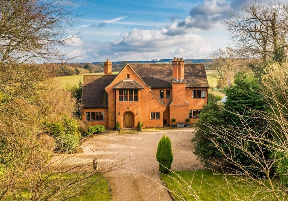 house. An impressive modern country house built in the Arts and Crafts style, with stunning rural views in Peaslake