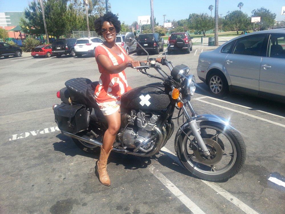 Akilah on T's Bike