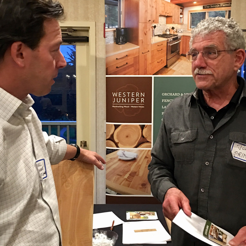 Michael Stevens from Sustainable Northwest Wood talks with John David—Lifetime Member of CLCA and owner of Prime Landscape.