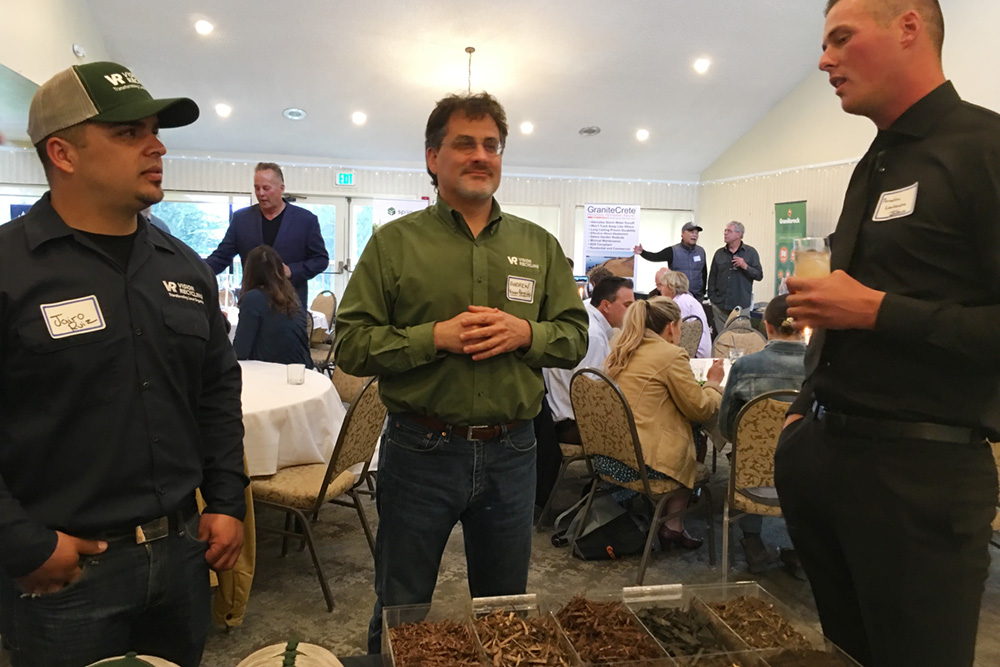 Central Coast's Andrew Tuckman, past Event Director, present Legislative Director, and owner of Vision Recycling, standing in the center with Jairo Ruiz and ?