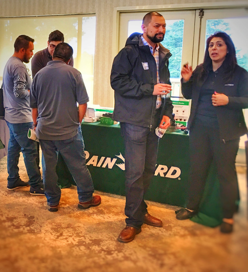 Rainbird's booth, Silvia Gourian on the right and in the way back on the left...can you find Fernando Terrazas—CLCA Central Coast's featured Partner this month?