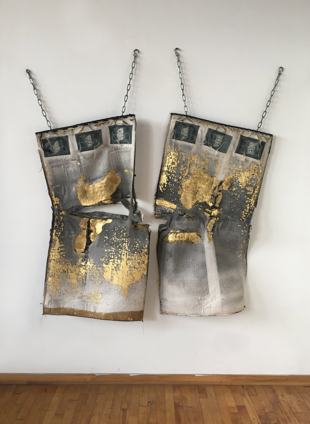 Cheryl Pope     Heavyweight (2017)     23k gold leaf, steel chains, used leathery Heavy boxing bag, duct tape