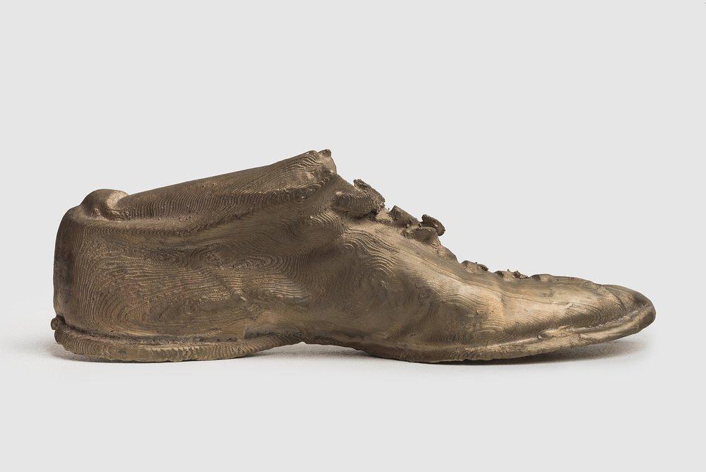 "HAE Boxing Shoe (Right/Half)   Cast Bronze  2016  2 ½"" h x 8 ¼"" w x 1 ¼"" d"