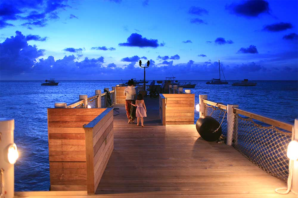 The watersports pier in the Caribbean Village is transformed into a barracuda-watching vodka bar in the evening. It's a beautiful place to watch the sunset above and the tropical fish below.