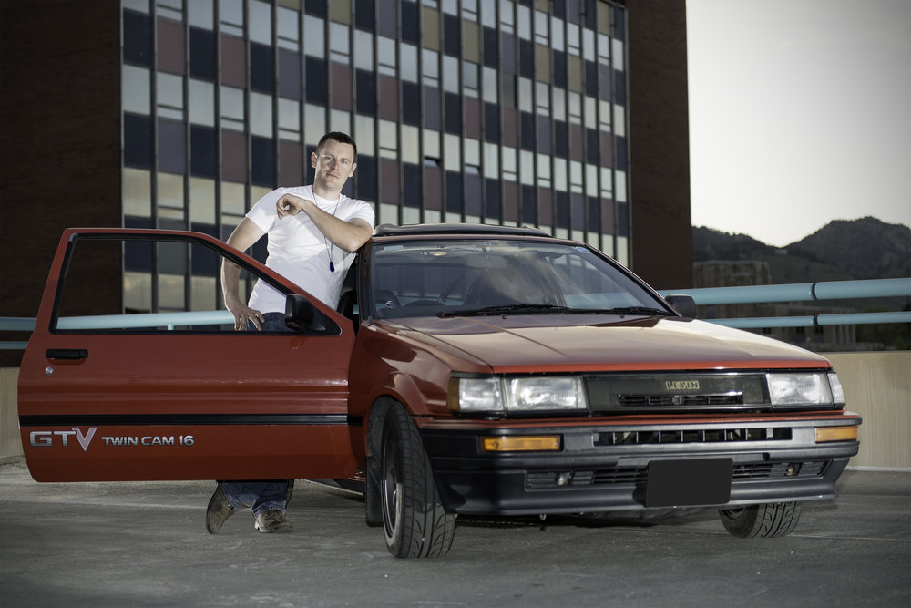 Nathan and his Toyota AE86  Location portrait on top of a parking garage in Boulder, CO.