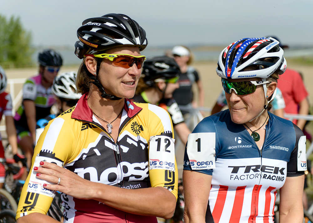 Meredith Miller and National Cyclocross Champion Katie Compton at the starting line of the US Open of Cyclocross. Boulder Reservoir. Boulder, CO.