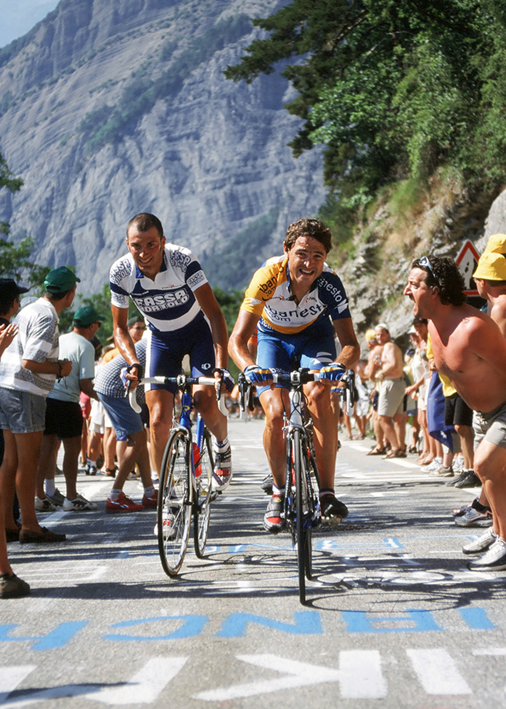 Ivan Basso & Francisco Mancebo climbing Alpe d'Huez at the Tour de France. Shot on film.