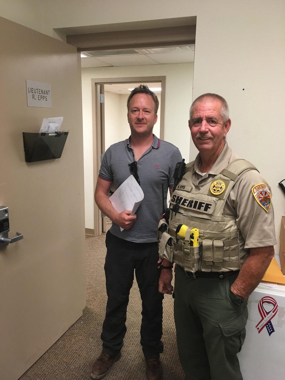 Alex Hannaford interviews a sheriff's office lieutenant for an episode of Dead Man Talking