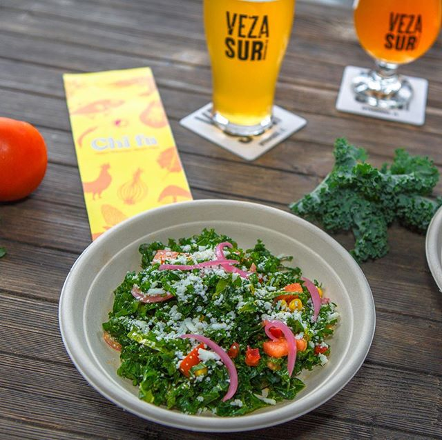 We're mad about #mangoes...and #kale. Our #kalesalad has #tomatoes #pickledonions #quesofresco and a #mango #vinaigrette. It pairs perfectly with the @vezasurbrewingco Mango #BlondeAle - swipe to see it. #tastingnotes #ChifaStreet #VezaSur