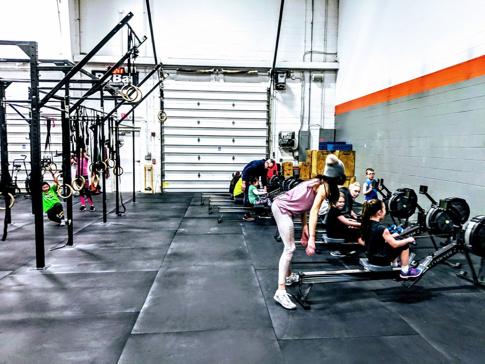 Trying out the rowers at CrossFit Enclave