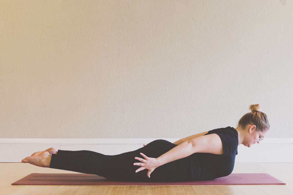 full locust - You'll start with the same set up you did for half locust. When you lift your head and chest lift your legs as well. Think about getting longer rather than lifting higher. Hold 3-5 breaths then rest. You can repeat that or move on to bow pose.
