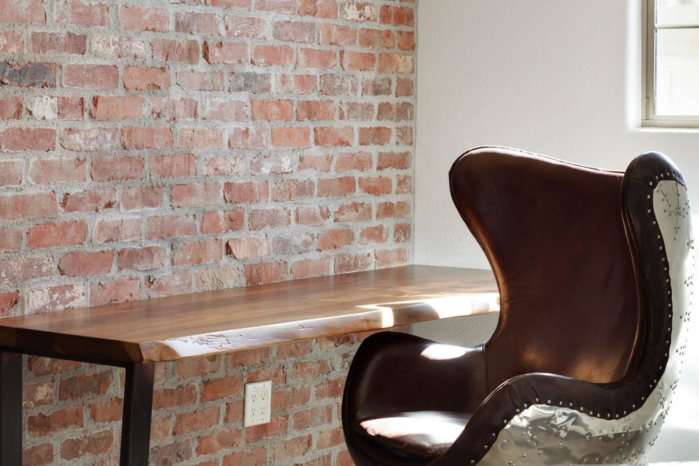Wooden table and stylish armchair detail