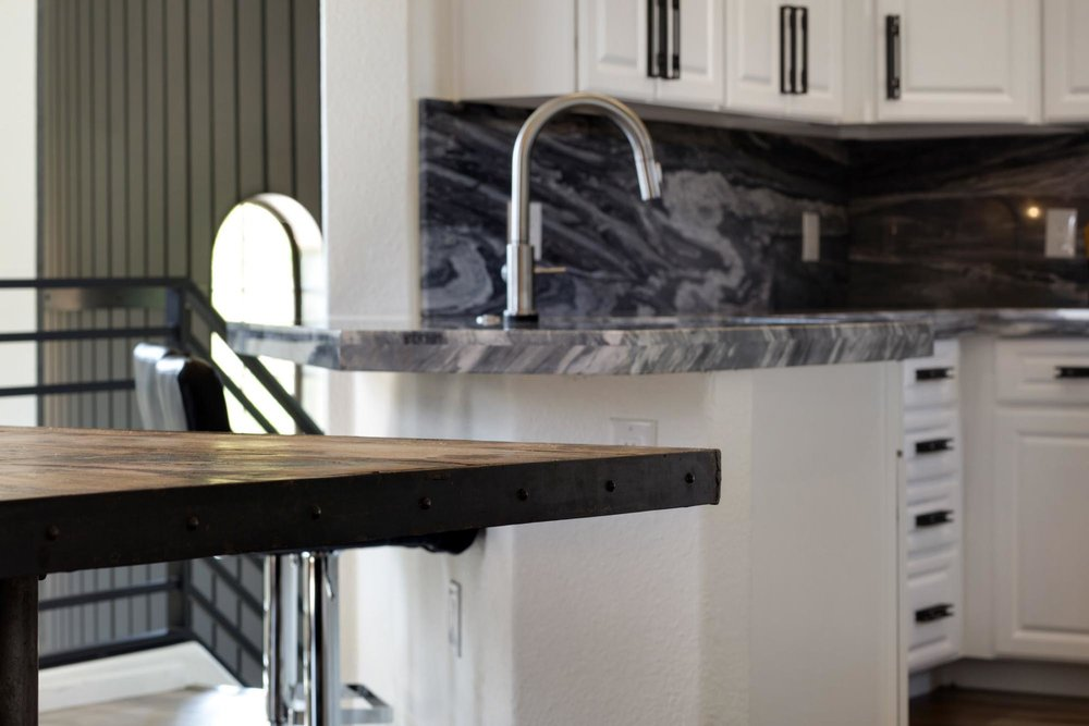 Kitchen with cabinets and stylish faucet