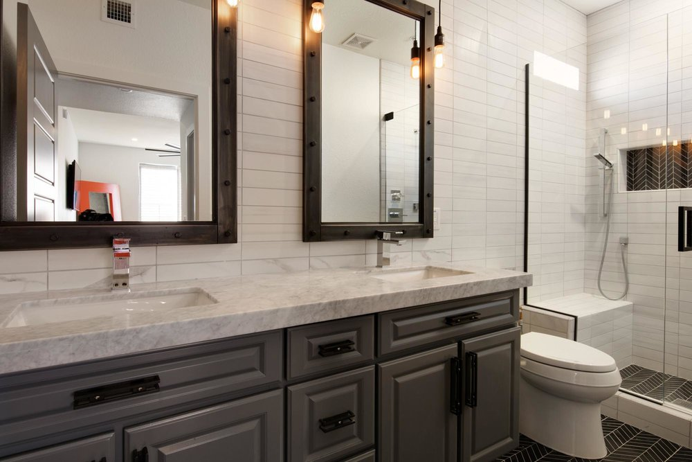 Bathroom with sink and faucet and  two large mirror