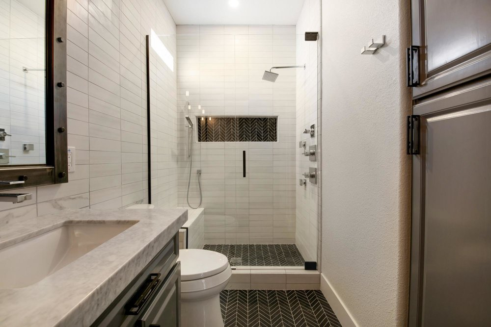 Bathroom with white toilet and glass shower room