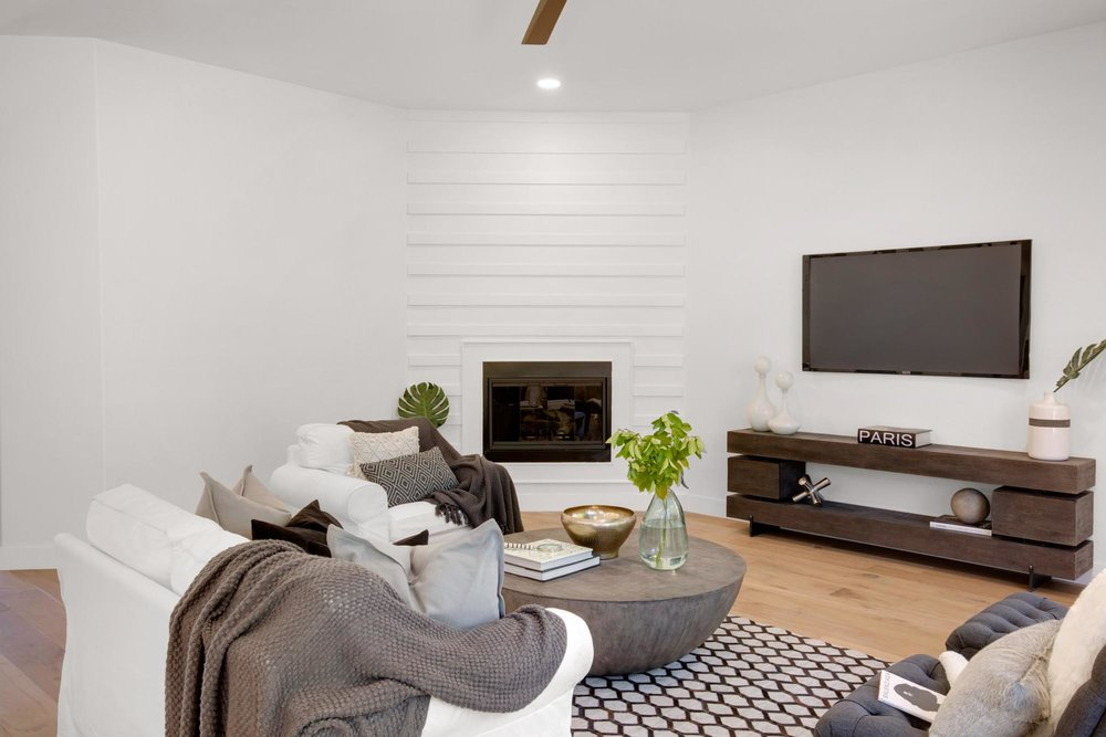 Modern living room with television and wooden shelves