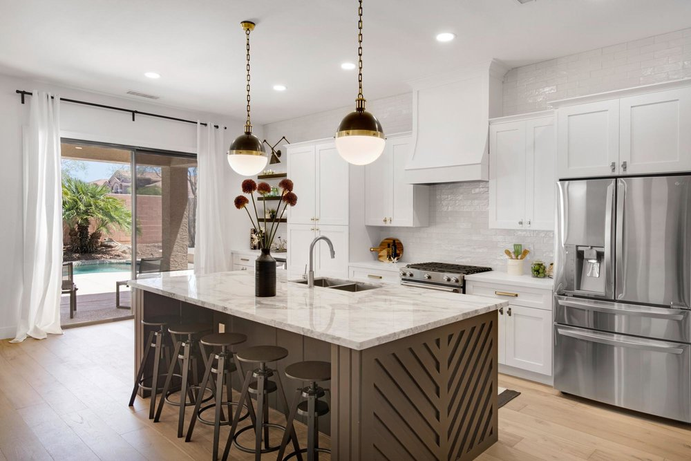 Elegant kitchen with island and five bar stools