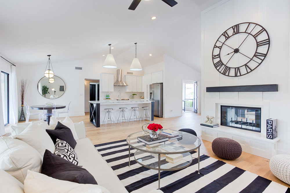 Modern living room with big round wall clock