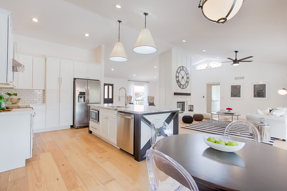 Kitchen and dining area with white stylish lights