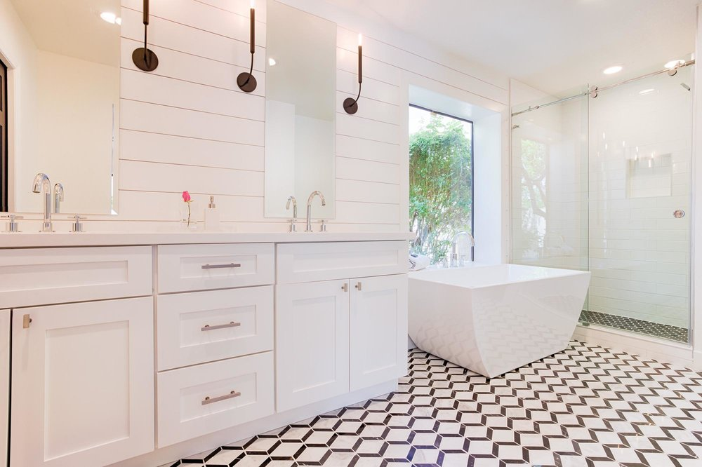 Bathroom with black and white patterned flooring