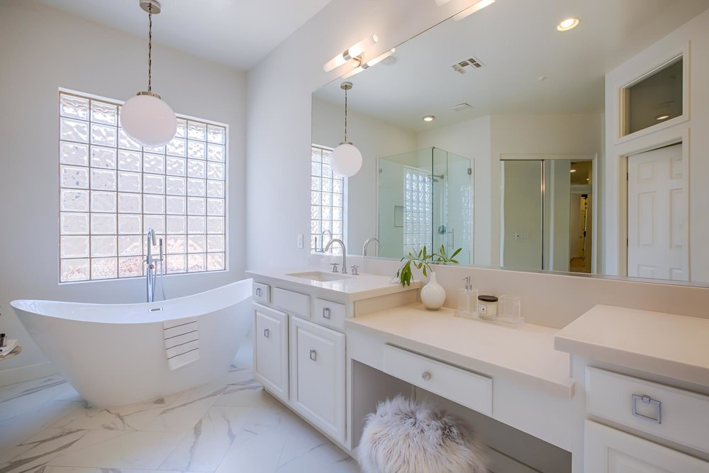Bathroom with white bathtub and hanging lights
