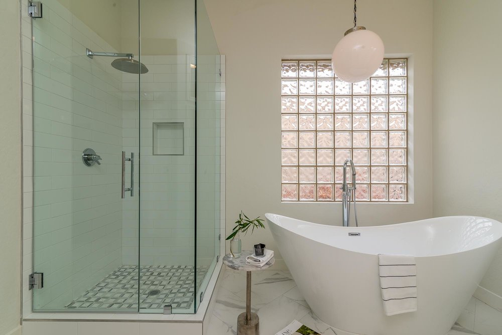 Bathroom with bathtub and glass shower room