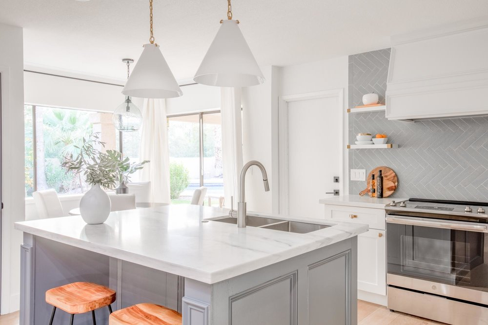 Modern kitchen with bar style island and white stylish hanging lights