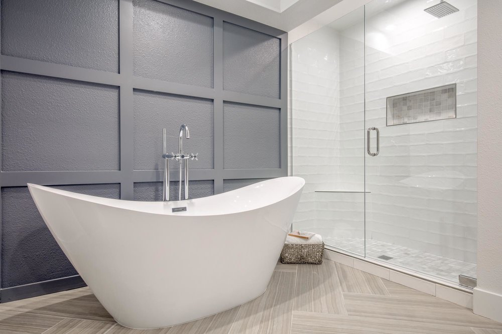 Bathroom with large white bathtub